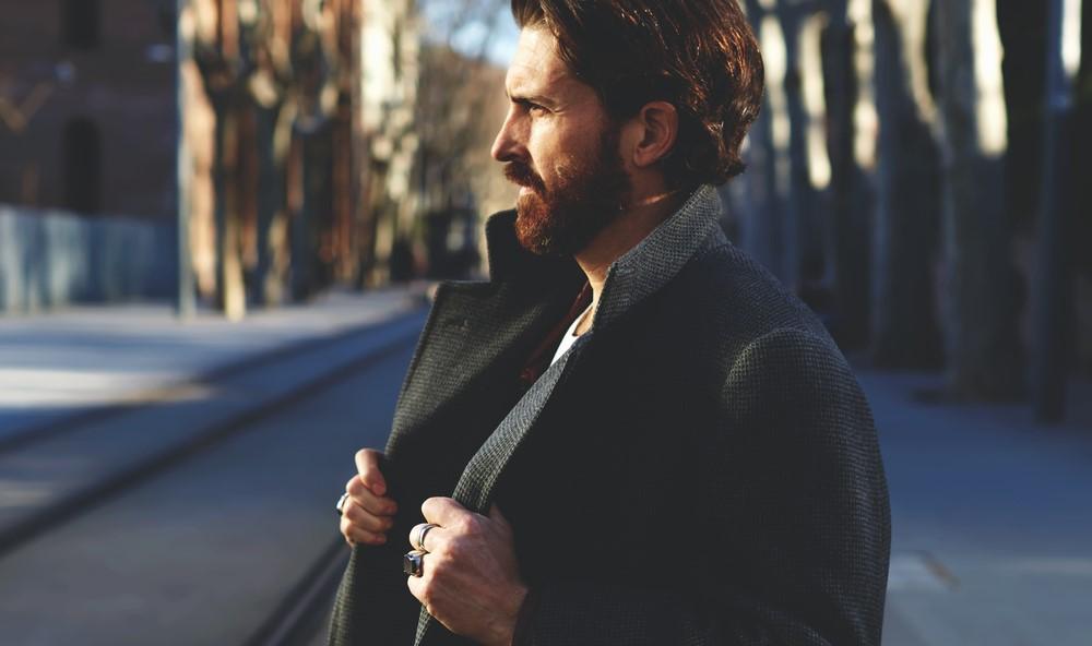 handsome elegant man in an autumn scenery